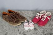 image of born  - Parent and new born child shoes on the floor - JPG