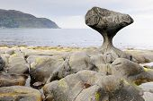 image of tide  - Rock formed by wind and water at Norwegian coast at low tide - JPG