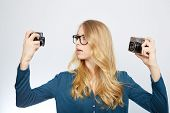 pic of analogy  - young woman taking picture with analog 35mm camera - JPG
