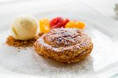 stock photo of cream puff  - Apple pie in puff pastry served with ice cream and candied fruit - JPG
