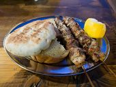 foto of souvlaki  - Pork Souvlaki served on the street in Athens Greece