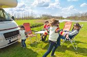 pic of camper  - Family vacation, RV (camper) travel with kids, happy parents with children on holiday trip in motorhome
