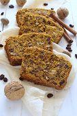 stock photo of pumpkin pie  - Spicy pumpkin cupcake with raisins and nuts - JPG