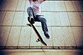 pic of skateboarding  - young skateboarder skateboarding ollie trick at city - JPG