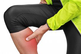 picture of calf  - closeup of a young caucasian sportsman wearing sport clothes with his hand in his calf because of his calf muscle pain - JPG