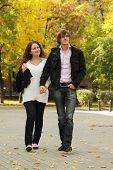 Couple Walking By Autumn Park