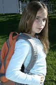 Girl wearing back pack