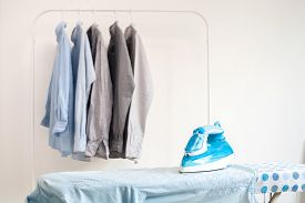 image of apparel  - ironing housework ironed folded shirts clean concept still life garment apparel cloth indoors - JPG