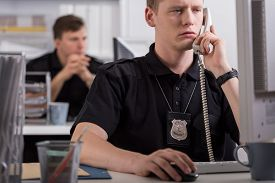 image of police  - Image of policeman during his work on police station - JPG