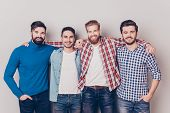Постер, плакат: Diversity Of Men Four Cheerful Young Guys Are Standing And Embracing Smiling On Pure Background I