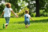 Children running outdoors on a sunny day