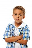 Little boy with crossed arms isolated on white