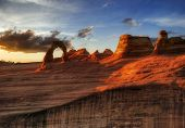 Sunset of Delicate Arch. It is photographed in Arches canyon. Utah. USA.