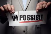 Businessman tearing the word impossible to make possible concept for self belief, positive attitude  poster