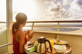 Cruise ship luxury travel woman eating breakfast from room service on suite balcony enjoying morning poster