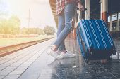 Traveler Girl With A Luggage Waiting For Train On The Station. Outdoor Adventure Travel By Train Con poster