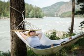Woman Resting In Hammock Outdoors. Sleeping Outdoors. poster