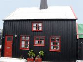 picture of faroe islands  - A corrugated roof tops this black and red house in Torshavn - JPG