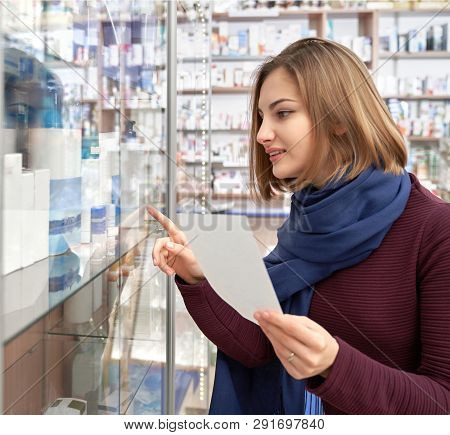 Pretty Woman Holding Prescription Paper