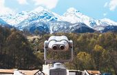 Touristic Telescope Look At The City With View Snow Mountains, Closeup Binocular On Background Viewp poster