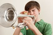 Teen Playing Silver Trumpet