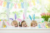 Kids On Easter Egg Hunt. Children Dye Eggs. poster