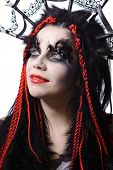 portrait of woman with voodoo shaman make-up isolated on white