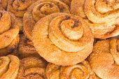 Lots Of  Fresh Rolls With Cinnamon And Sugar