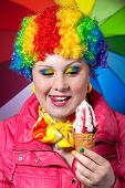 Clown With Rainbow Make Up Eating Ice Cream