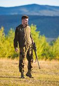 Mental Preparation For Hunting Individual Process. Man Rifle For Hunt. Hunter Khaki Clothes Ready To poster