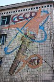 Chernobyl area. Lost city Pripyat. Modern ruins. Remains of Communist slogan. Ukraine. Kiev region.