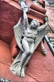 HDR.Architecture demon with wings on wall of house in Kiev, Ukraine