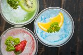 Blue Red Green Italian Soda Cold Beverage And Lemon Strawberry Kiwi Fruit And Parsley. Blue Red Gree poster