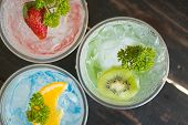 Green Red Blue Italian Soda Cold Beverage And Kiwi Strawberry Lemon Fruit And Parsley. Green Red Blu poster