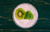 Green Italian Soda Cold Beverage And Kiwi Fruit And Parsley. Green Italian Soda Cold Beverage With K poster