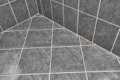 Tiled bathroom floor reflecting light poster