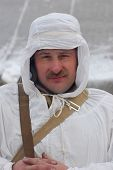 KIEV, UKRAINE - FEB 20: A member of military history club RedStar  wears historical Soviet uniform  during historical reenactment of WWII,February 20, 2011 in Kiev, Ukraine
