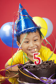 picture of happy birthday  - Happy asian boy celebrating birthday his fifth birthday - JPG