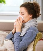 Sick Woman.Flu.Woman Caught Cold. Sneezing into Tissue. Headache. Virus