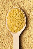 the bulgur wheat in wooden spoon