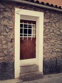stone facade with wooden door