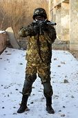 Soldier In Camouflage With Rifle