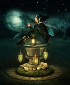 stock photo of pixie  - a little pixie with lanterns sitting on a altar of stone - JPG