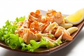 Pasta Penne with Salmon Slice and Red Caviar. Garnished on Salad Leaf with Cream Cheese Sauce and Le