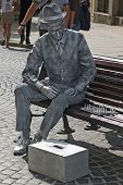 Living Statue - A Man Playing Chess On The Bench