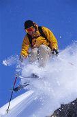 Man Skiing Off Mountain