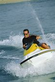 picture of ski boat  - Man jet skiing and smiling  - JPG