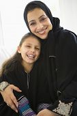 Middle Eastern Mother And Daughter At Home