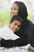 Middle Eastern Woman Sat In Park With Son