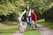 Children Leading Woman Down Path